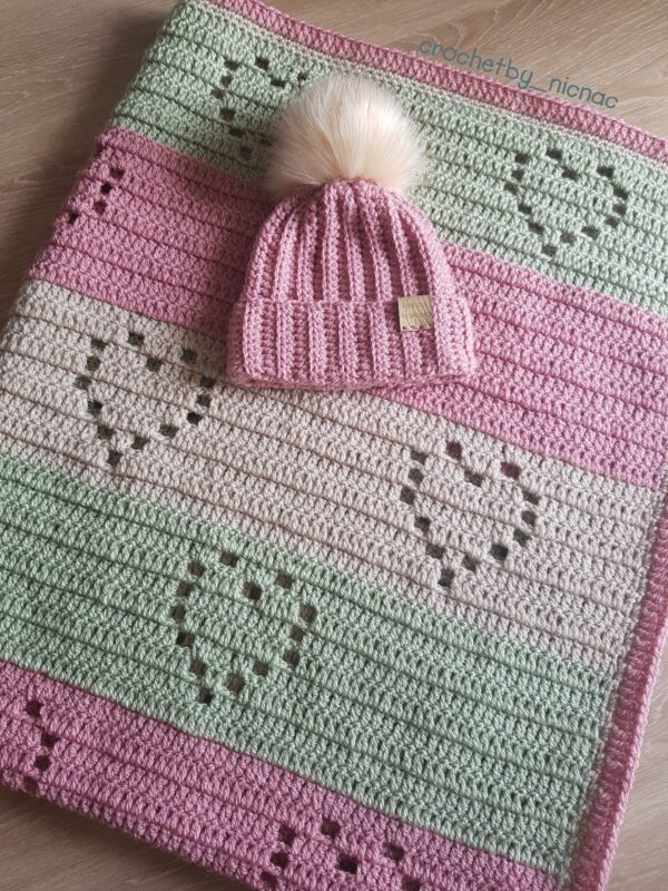 Crocheted Love heart blanket with pom pom beanie hat. - main product image